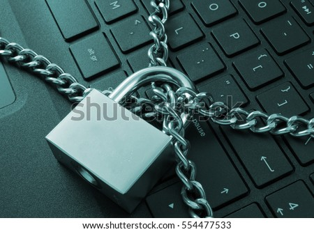 Cyber safety concept, locked chain on laptop computer keyboard