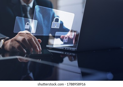 Cyber security, Business, technology, internet network, software development, digital data protection concept. Businessman working on laptop computer in office with pop up antivirus system