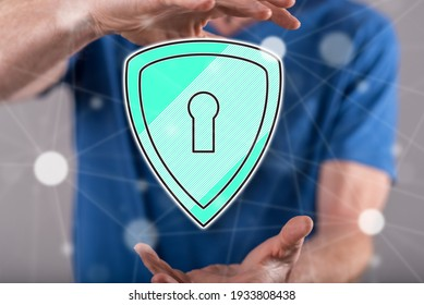 Cyber security concept between hands of a man in background