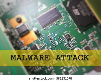 Cyber security concept. Computer electronic board circuit with word malware attack
