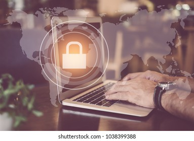 Cyber security concept. man using computer with internet network security icon and world map background.