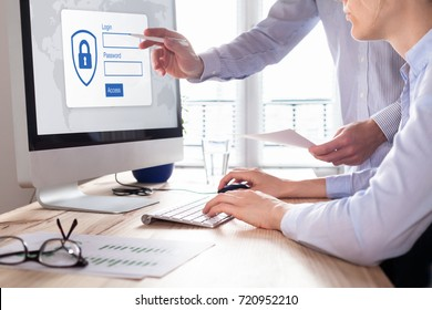 Cyber security concept with manager providing authentication credentials (login, password) to business person to access confidential data on computer screen