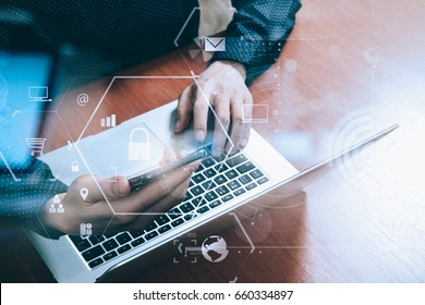 cyber security internet and networking concept.Businessman hand working with VR screen padlock icon and mobile phone and laptop computer