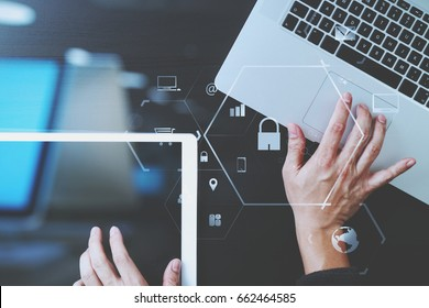 cyber security internet and networking concept.Businessman hand working with VR screen padlock icon on laptop computer and digital tablet