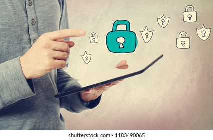 Cyber Security with man holding a tablet computer