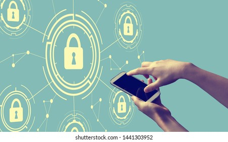 Cyber security theme with person holding a white smartphone