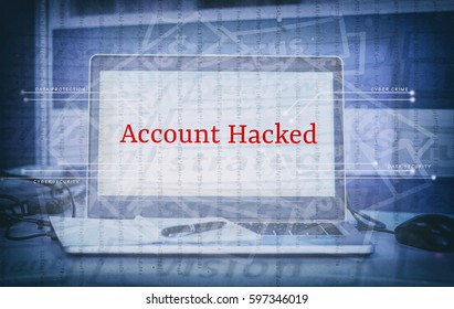 Cyber security and threat concept with word ACCOUNT HACKED display on laptop screen and abstract background