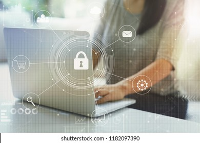 Cyber security with woman using her laptop in a living room