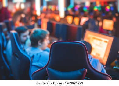 Cyber sport e-sports tournament, team of professional gamers, close-up on gamer's hands on a keyboard, pushing button, gamers playing in competitive moba, strategy fps game in a cyber games arena club