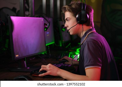 Cyber sport. Fully concentrated professional cybersport player playing important match