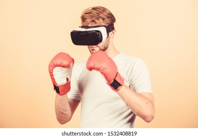 Cyber sportsman boxing gloves. Man play game in VR glasses. Cyber sport concept. Man boxer virtual reality headset simulation. Cyber coach online training. Explore cyber space. Augmented 3D world.