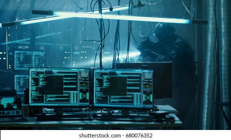 Cyber War Special Forces Fully Armed Soldier Uncovers Internationally Wanted Hacker's Hideout Place. Lair is Full of Monitors, Cables and Has Neon Lights.