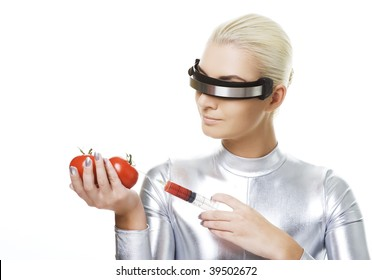 Cyber woman taking vitamins from tomatoes