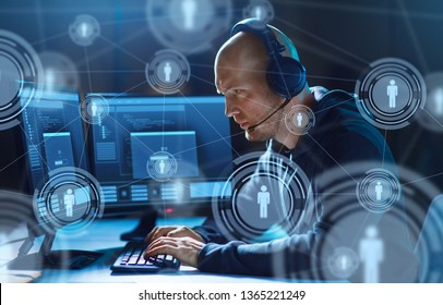 cybercrime, hacking and technology concept - male hacker in headset with progress loading bar on computer screen wiretapping or using virus program for cyber attack in dark room