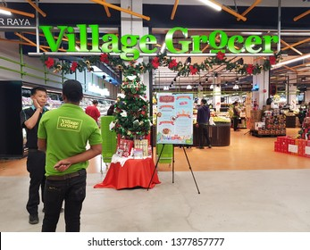Cyberjaya, Malaysia. November 26, 2018. Village Grocer workers standing in front of the store at Tamarind Square, a new shopping complex in Cyberjaya