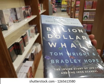 Cyberjaya, Malaysia. October 30, 2018. Billion Dollar Whale book by Tom Wright and Bradley Hope, held by a customers, on sale at MPH Bookstore, D'Pulze Shopping Centre in Cyberjaya Sepang