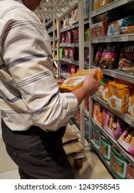 Cyberjaya, Selangor. October 26, 2018. Customer pickup a Julie's Cream Cracker from display shelf at Jaya Grocer Supermarket at Cyberjaya, Selangor