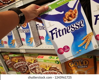 Cyberjaya, Selangor. October 26, 2018. Customer pickup a Nestle Fitnesse cereal box from display shelf at Jaya Grocer Supermarket at Cyberjaya, Selangor