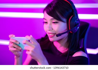 cybersport gamer playing mobile game on the smart phone