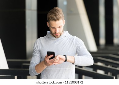 cybersport. man hold smartphone and look at smart watch, cybersport. digital sport and cybersport concept. cybersport for modern people. ready to win