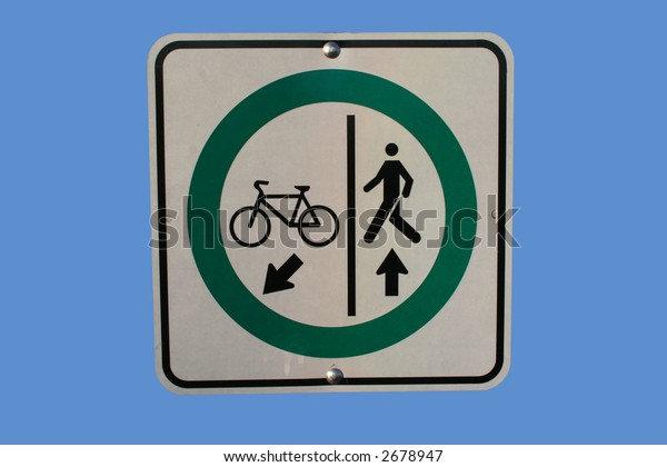 Cycle and pedestrian lanes sign isolated on blue