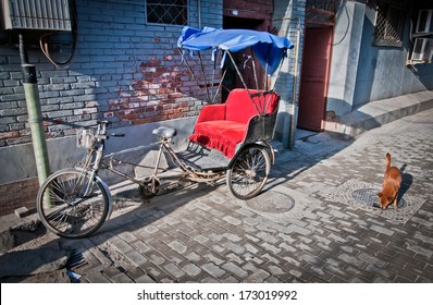 cycle rickshaw on narrow alley in hutong area in Beijing, China