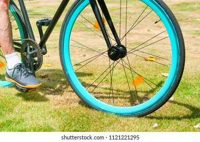 Cycler with bicycle in a park at summer