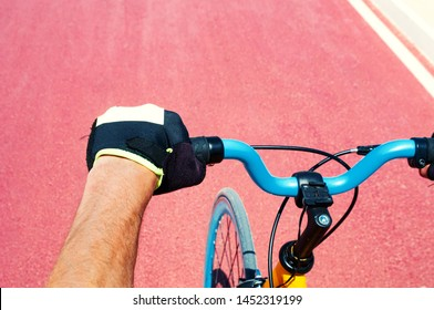 Cycler driving his bicycle on red road