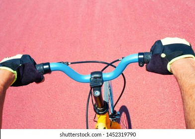 Cycler riding his bicycle on a red road