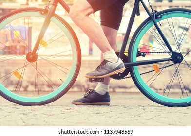 Cycler`s foot on pedal bicycle close up in a park