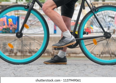 Cycler`s foot on pedal bicycle close up in a park at summer