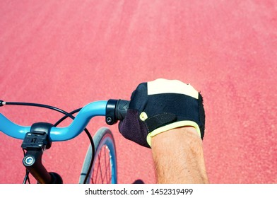 Cycler`s hand  on helm of bicycle