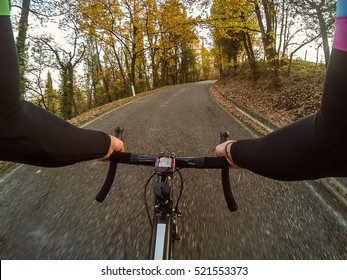 Cycling in autumn season in Tuscan countryside. Cyclist personal perspective