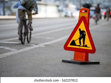 Cycling in the city. Construction sign.