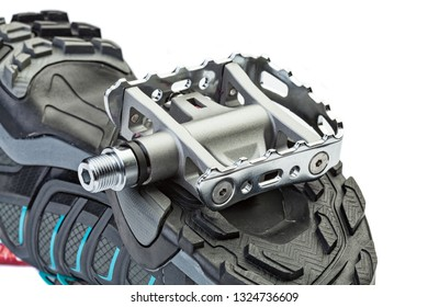 Cycling  clipless sistem pedal attached to the sole of the shoe.  Close up.