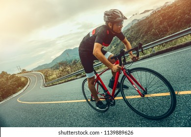 Cycling competition, cyclist athletes riding a race at high speed on mountain road, Sportsmen bikes in the morning,vintage color,selective focus, sports concept,
