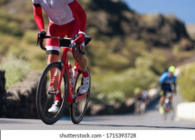 Cycling competition,cyclist athletes riding a race, climbing up a hill on a bicycle