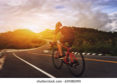 Cycling competition,cyclist athletes riding a race at high speed on mountain road, Sportsmen bikes in the morning,vintage color,selective focus, sports concept,low angle view,Business competition