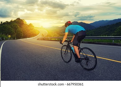 Cycling competition,cyclist athletes riding a race at high speed on mountain road, Sportsmen bikes in the morning,vintage color,selective focus, sports concept
