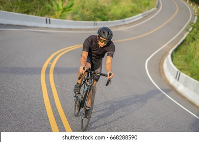 Cycling competition,cyclist athletes riding a race at high speed on mountain road, Sportswomen bikes in the morning,vintage color,selective focus, sports concept,Business competition,copy space