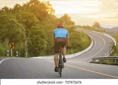 Cycling competition,cyclist athletes riding a race at high speed on mountain road, Sportsmen bikes in the morning,back view,vintage color,selective focus, sports concept,copy space