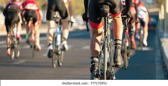 Cycling competition,cyclist athletes riding a race in the light of evening