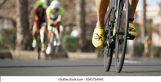 Cycling competition,cyclist athletes riding a race,racing bike during ironman competition.Racing- bike