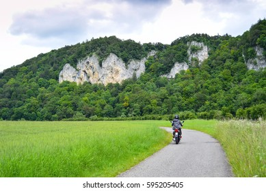 cycling, feel free on the bike, bike tours in germany, donau radweg, bycicle tour along the danube, motorbiker on the road near the danube, rocky hills, danube breakthrough, upper section, motorbike
