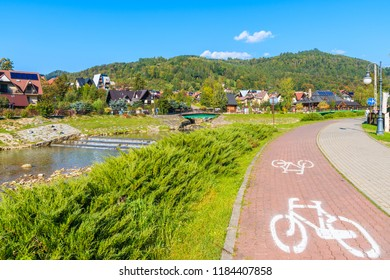 Cycling lane along Grajcarek river and promenade in Szczawnica town, Pieniny Mountains, Poland