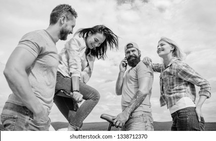 Cycling modernity and national culture. Double date concept. Group friends hang out with bicycle. Company stylish young people spend leisure outdoors sky background. Couple meet friends with bicycle.