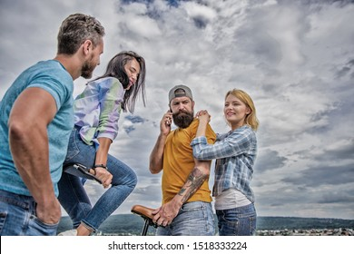 Cycling modernity and national culture. Group friends hang out with bicycle. Company stylish young people spend leisure outdoors sky background. Couple meet friends with bicycle. Double date concept.