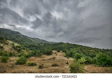 Cycling mountain road. Misty mountain road in high mountains. Cloudy sky with mountain road of Azerbaijan. Caucasus