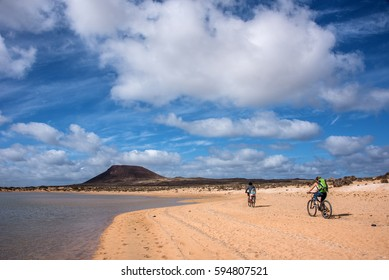 Cycling on the beach at Lanzarote, Canary Islands, Spain.