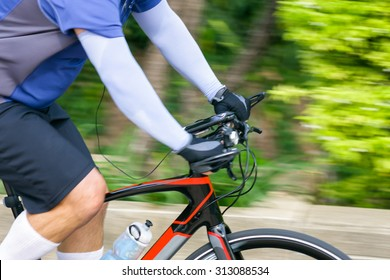 Cycling in the park, Close-up and pan camera left to right.